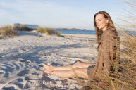 Woman enjoying beach, Sardinia, Italy - CUF38704