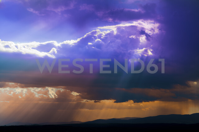 Germany, dark and dramatic cloudy mood during thunderstorm - EJWF00896
