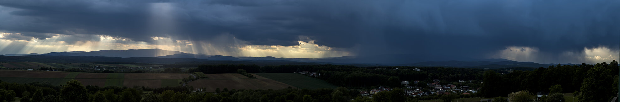 Germany, panoramic view, dark and dramatic cloudy mood during thunderstorm - EJWF00899