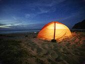 USA, Hawaii, Kauai, Polihale State Park, illuminated tent on the beach at night - CVF00933