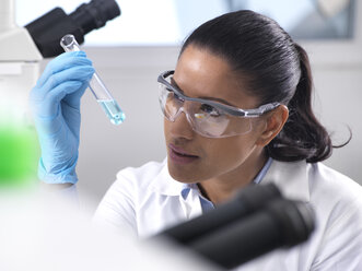 Biotechnology Research, female scientist mixing a chemical formula - ABRF00166