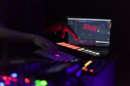 DJ working on drum machine - AFVF00661