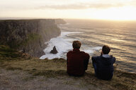 Two men sitting on The Cliffs of Moher, The Burren, County Clare, Ireland - ISF16288