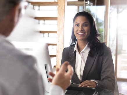 Portrait of smiling businesswoman in a meeting - ABRF00205