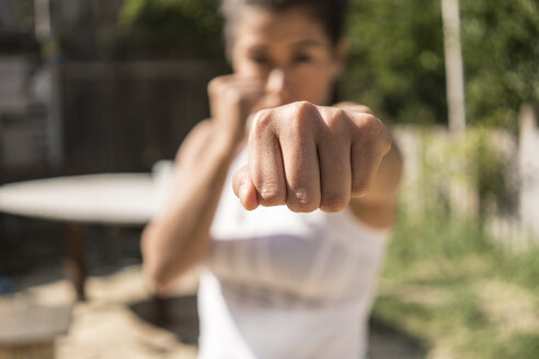 Fist of selfdefending young woman, close-up - TAMF01097