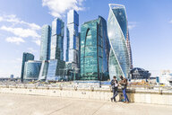 Russia, Moscow, two businessmen standing in front of modern office towers - WPEF00600