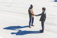 Two businessmen shaking hands outdoors - WPEF00612