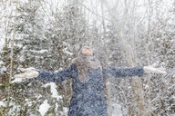 Happy woman throwing with snow and having fun - WPEF00617
