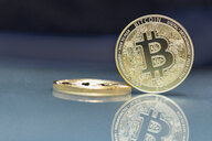 Bitcoins on glass, copy space - MMA00410