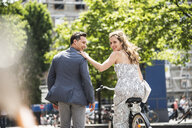 Happy couple with bicycle in the city - UUF14422