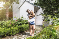 Young couple hugging in garden - CUF39108