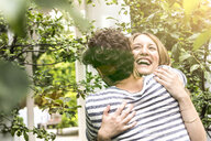 Young couple hugging in garden - CUF39111
