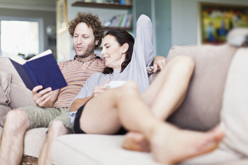 Couple relaxing together on sofa - CUF39277