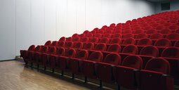 Red chairs in empty auditorium - CUF39567
