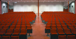 Red chairs in empty auditorium - CUF39570