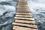 Wooden boardwalk across water - CUF39585