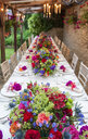 Elevated view of long table at wedding reception - CUF39591