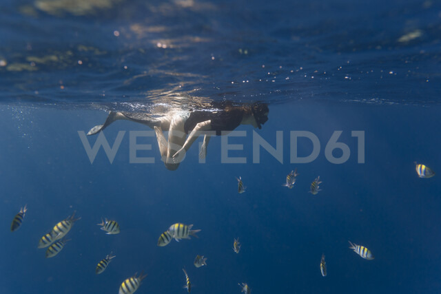 Indonesia, Bali, young woman snorkeling - KNTF01130
