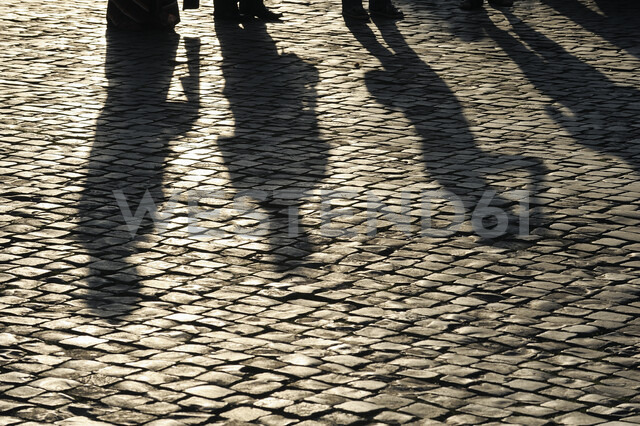 Italy, Rome, people's shadows on cobblestone - RUEF01893