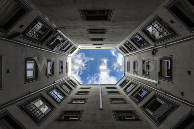 Spain, Madrid, Nuevos Ministerios, worm's eye view of courtyard of a building - KKA01146