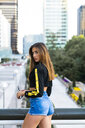 Portrait of attractive young woman in the city - KKAF01176