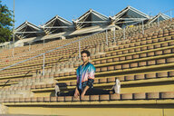 Man doing side splits on stairs of a stadium - AFVF00681