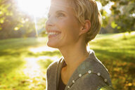 Woman smiling in park - CUF39625