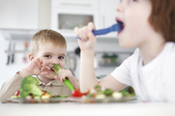 Children eating together at table - CUF39736