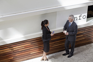Businesspeople standing having conversation - CUF39926