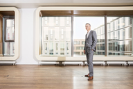 Businessman standing in office - CUF39938