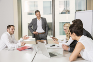 Businesspeople meeting in conference room - CUF39995