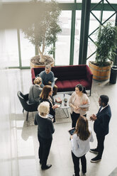 High angle view of business people discussing in meeting at office - MASF08059