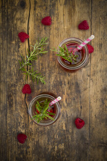 Two glass bottles of homemade raspberry lemonade flavoured with rosemary - LVF07236