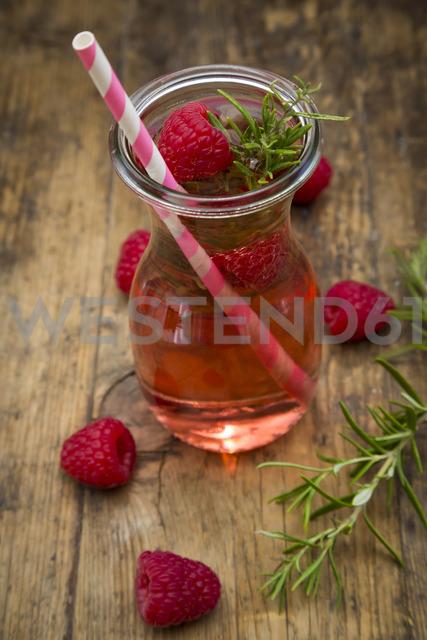 Glass bottle of homemade raspberry lemonade flavoured with rosemary - LVF07239