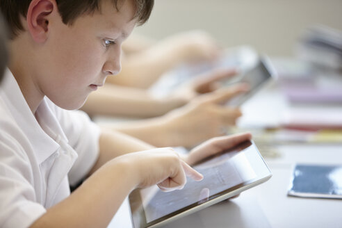 Close up of schoolchildren working in class - CUF40077