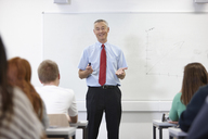 Mature male teacher in front of class - CUF40086