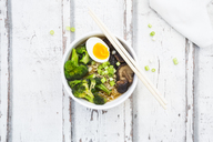 Bowl of Ramen soup with egg, broccoli, noodles, shitake mushroom and spring onions - LVF07245