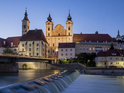 Austria, Upper Austria, Steyr, River Enns and St Michael's Church at blue hour - EJWF00900