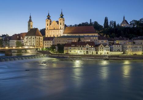 Austria, Upper Austria, Steyr, River Enns and St Michael's Church at blue hour - EJWF00903