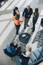 High angle view of male and female business colleagues greeting at conference - MASF08360