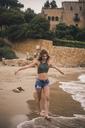 Beautiful young woman walking on the beach - ACPF00113