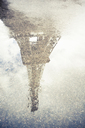 Eiffel Tower reflected in puddle - CUF40292