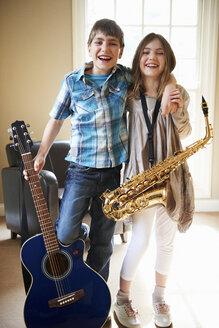 Children holding musical instruments - CUF40339