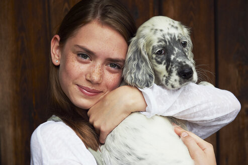 Teenage girl holding dog - CUF40357