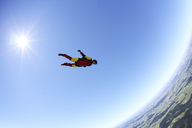 Skydiver free falling face down above Leutkirch, Bavaria, Germany - CUF40377