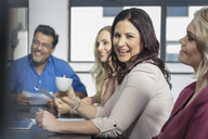 Happy businesswoman on a meeting in conference room - ZEF15810