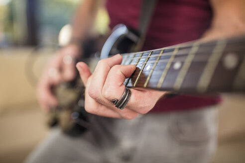 Close-up of man's hand playing electric guitar - ZEF15831