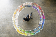 Businessman examining paint swatches - CUF40716