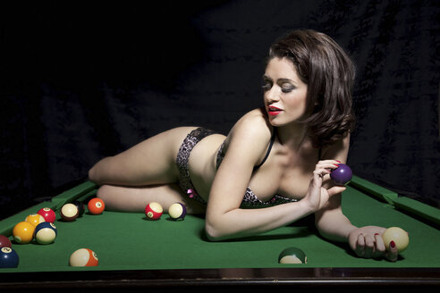 Woman in lingerie on pool table - CUF40854
