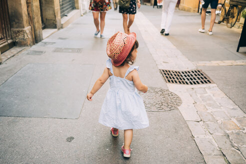 France, Aix-en-Provence, toddler girl walking down the streets of the city center - GEMF02110